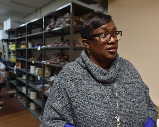Voulnteer services coordinator Michele McCallum stands Nov. 14, 2018, in the doorway of the new food pantry open on Wednesdays to veterans who meet various need criteria. The VA in Jackson has partnered with the Mississippi Food Network and the VFW to help feed families of veterans.