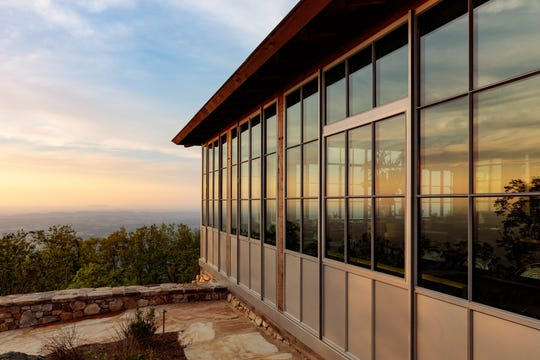 The Firetower restaurant is built around a restored 1940s lookout tower atop the 2,843-foot peak of Blackberry Mountain.