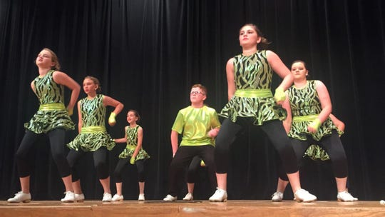 The Tennessee Valley Cloggers go through a competitive routine.