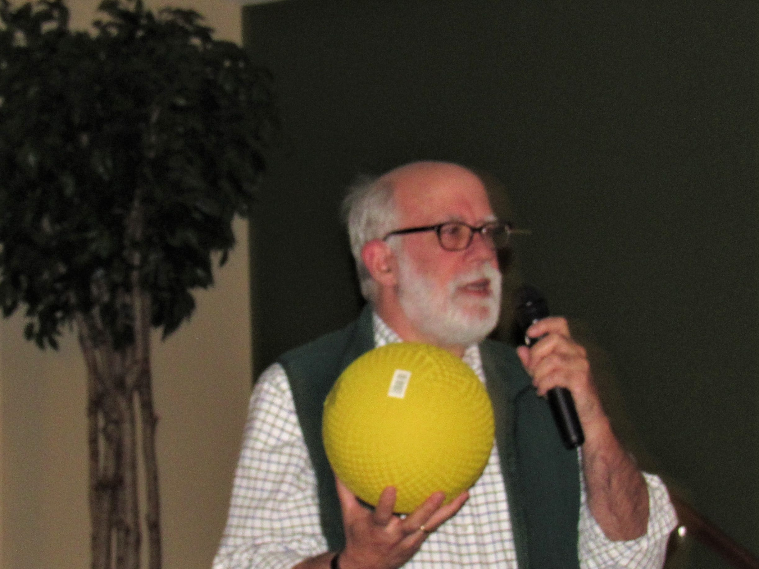 Author and speaker Richard Cook spoke at Sherrill Hills on Nov. 13.  The ball he is holding represents 142 pounds of uranium.