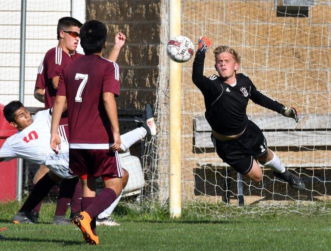 Faith Christian goalkeeper Cole Ungaro makes a save against Twin Lakes during the 2018 season.