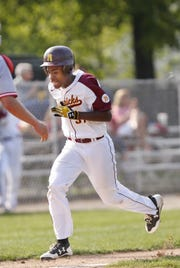 This file photo shows Jontae Billups-Brooks during the May 10, 2017, McCutcheon baseball game against West Lafayette. Billups-Brooks is seen just before scoring.  He was shot and killed about 4:30 a.m. Sunday at a southside apartment complex.