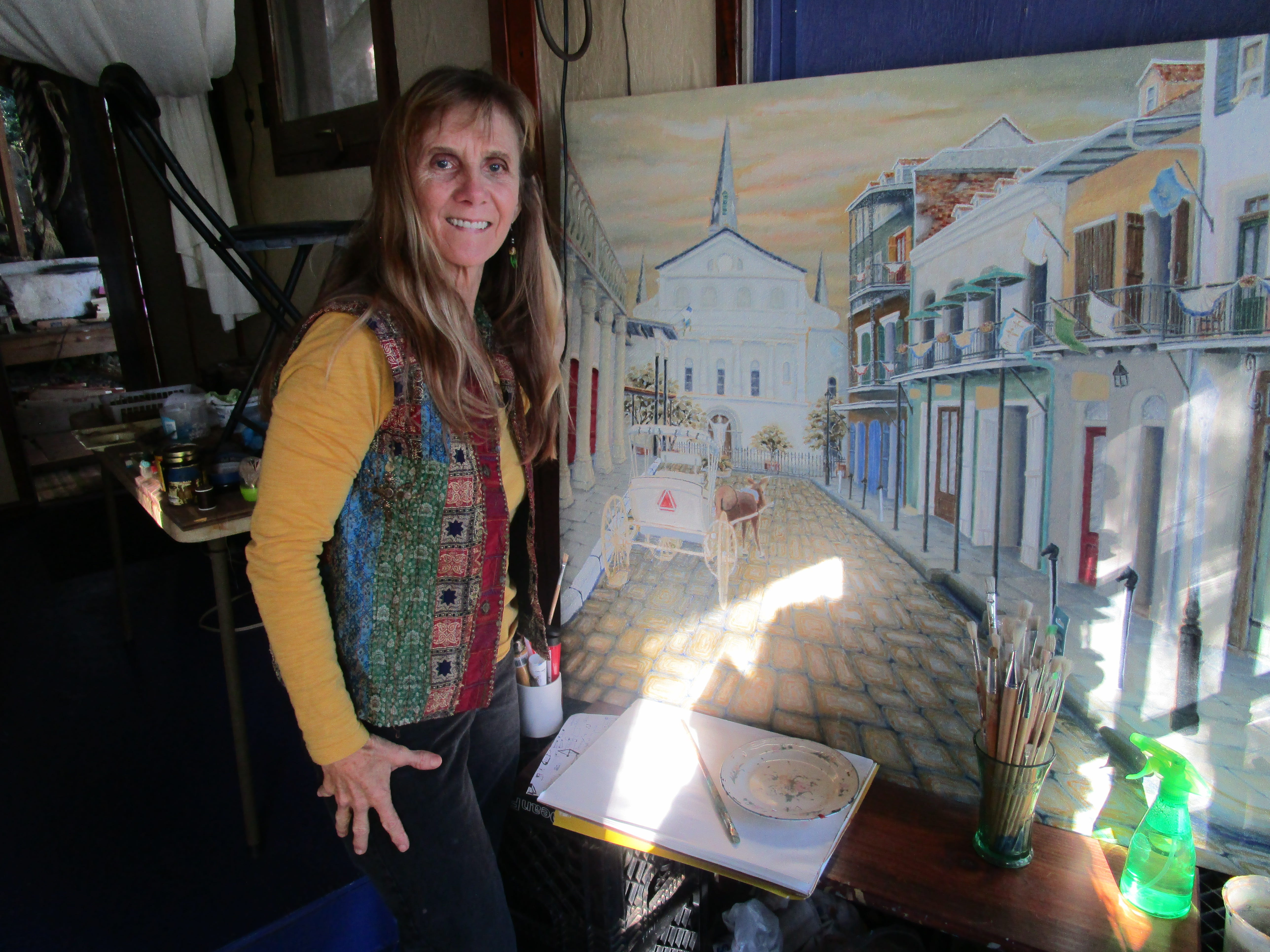 Kathleen Whitehurst works on one of her paintings.