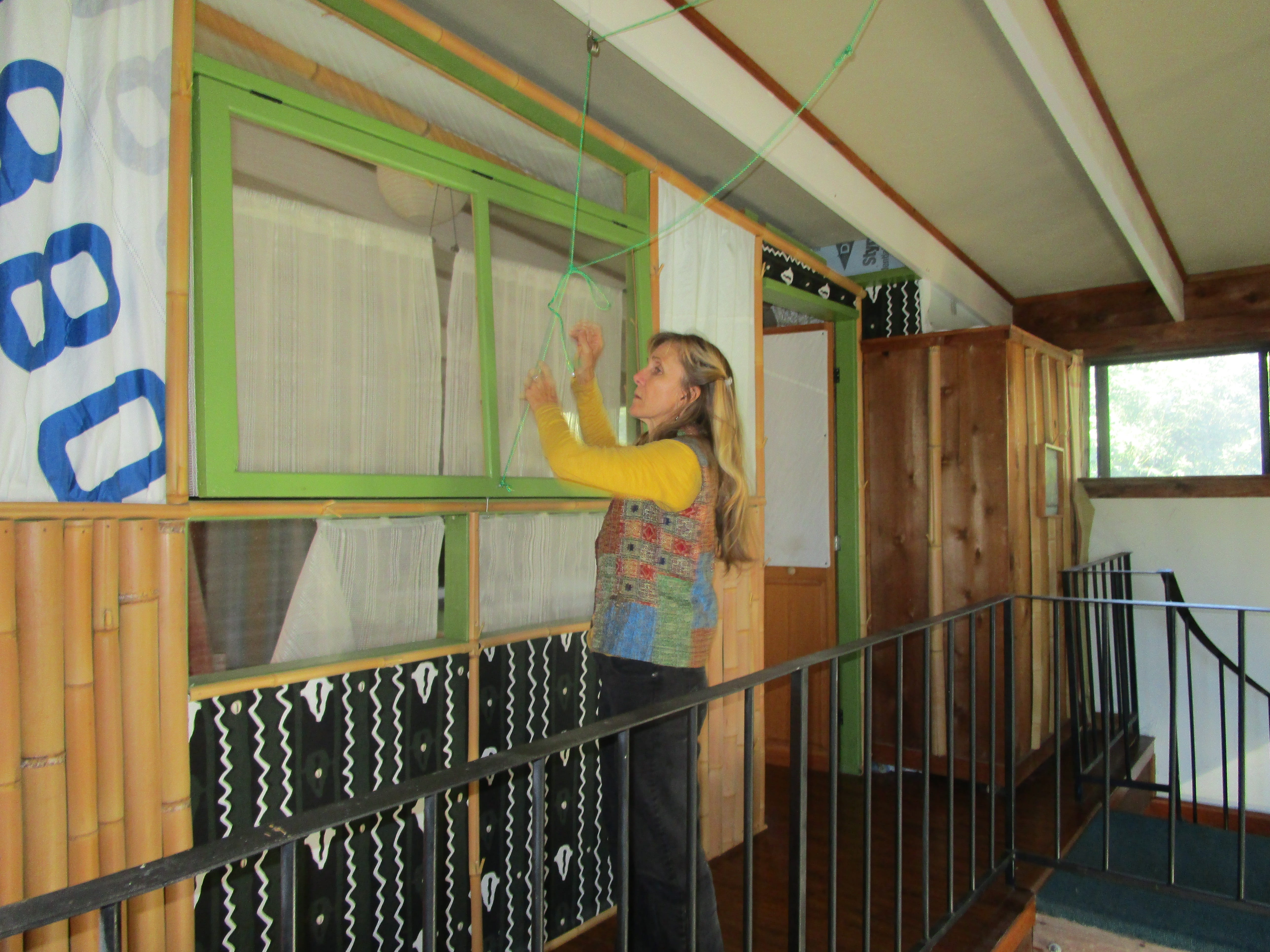 Kathleen Whitehurst shows the window she made herself.