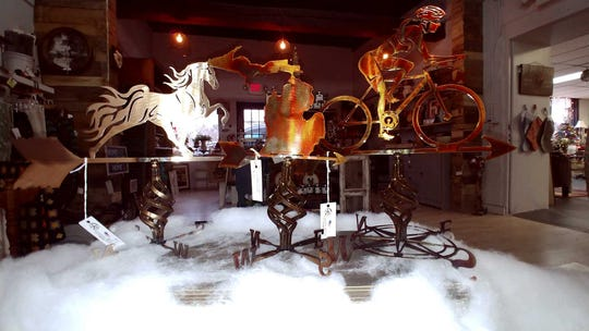 Tabletop weather vanes made by Livingston County metalworker Jeff MacGahey are among Michigan-made decor and furniture on sale at Heritage Home Accents & Decor in Brighton Township