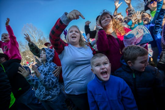 Children and parents try to get Santa Claus' attention to receive gifts from the back of the Santa Train, in St. Paul, Virginia. Nov. 17, 2018.
