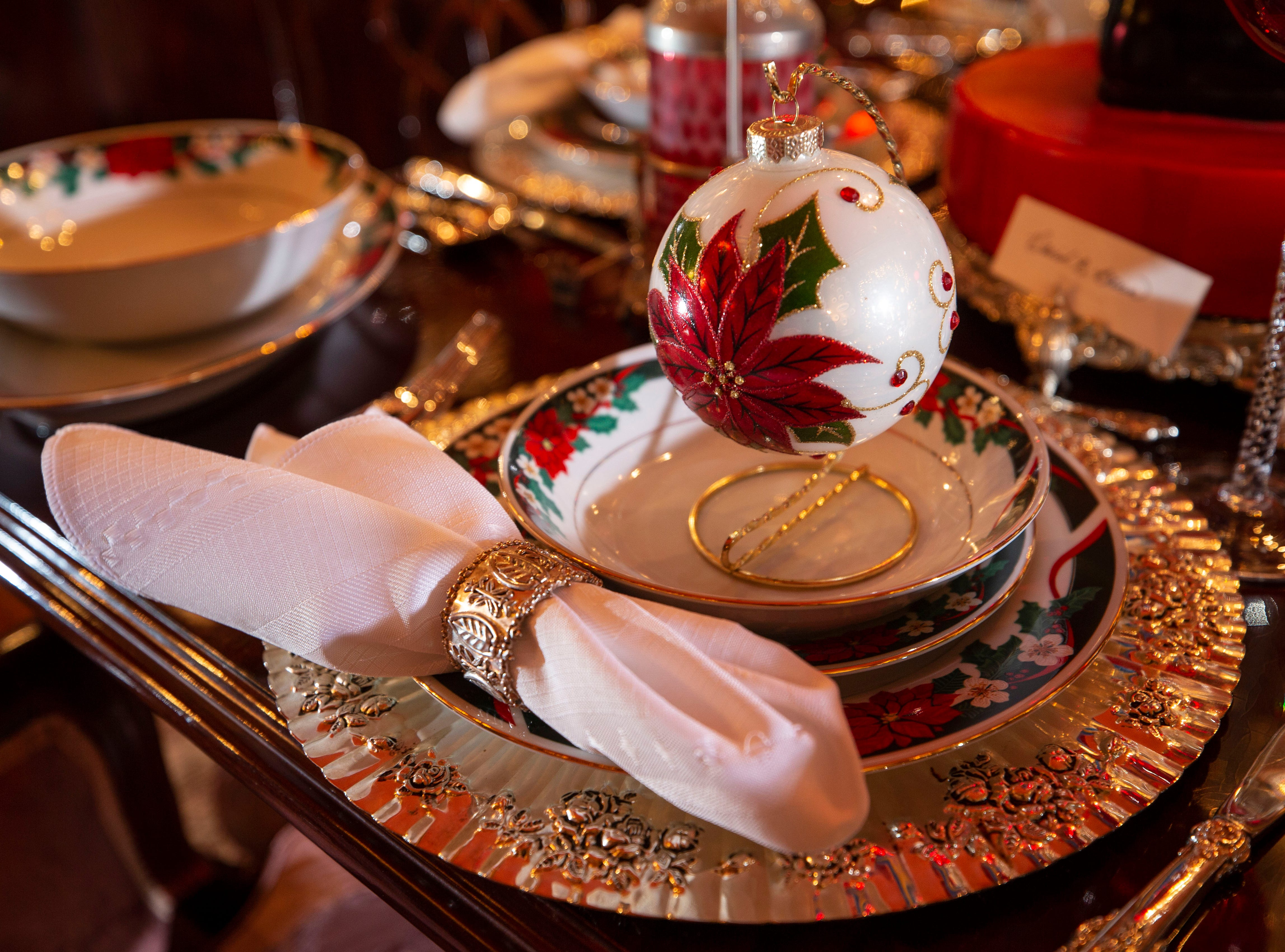 """""""You get to eat there and you get to socialize, and it's full of love. There's tons of memories in that room,"""" said David Brown about the dining room. There's ornaments that hang above the china setting."""