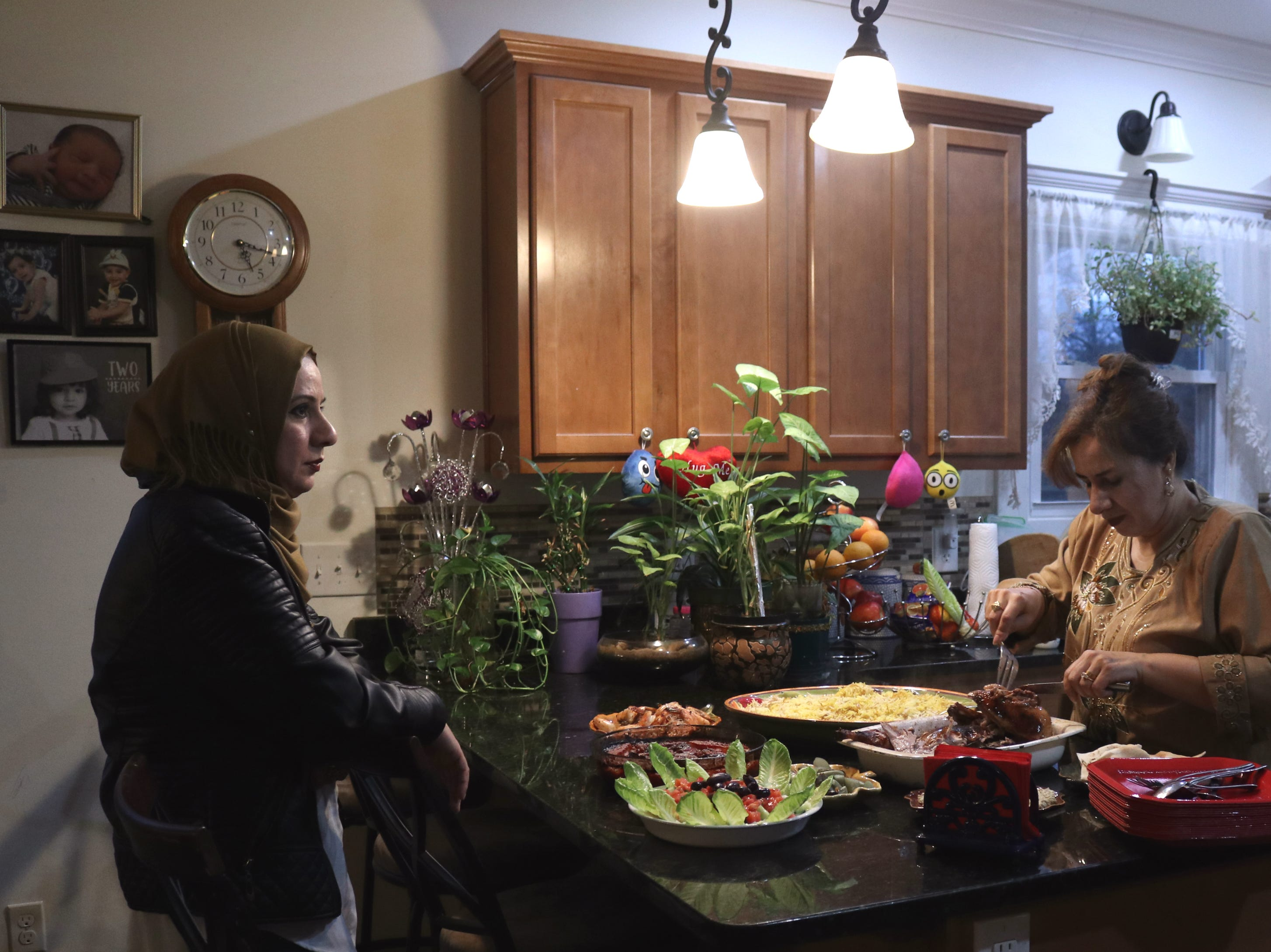 Zainab Radhi (right) made duck, rice, shrimp and roasted eggplant for dinner with her family on a recent Sunday night. She and her sister, Zina Radhi (left), said food is very important to Iraqi culture.