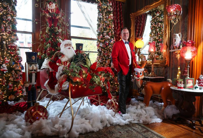 """""""When I walked in, I was placing Christmas trees,"""" said David Brown. Brown bought this 6,000-square foot Old Louisville home in 2009. The 19th century brick home needed extensive repairs and renovations. Now, the Victorian-era, three-story home is back to its grandeur and filled with Christmas and Holiday lights, trees and ornaments that is part of the Old Louisville Holiday Home Tour."""