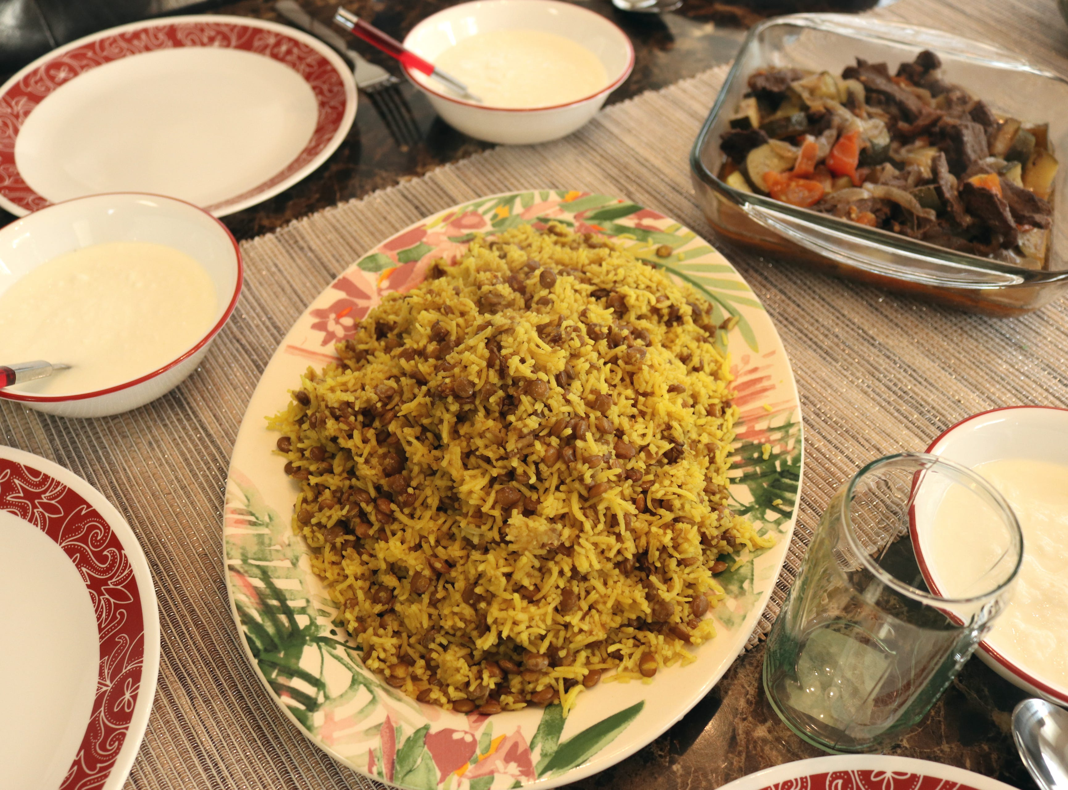 Zina Radhi served rice with lentils and seasoned beef at a Sunday night dinner with her family.