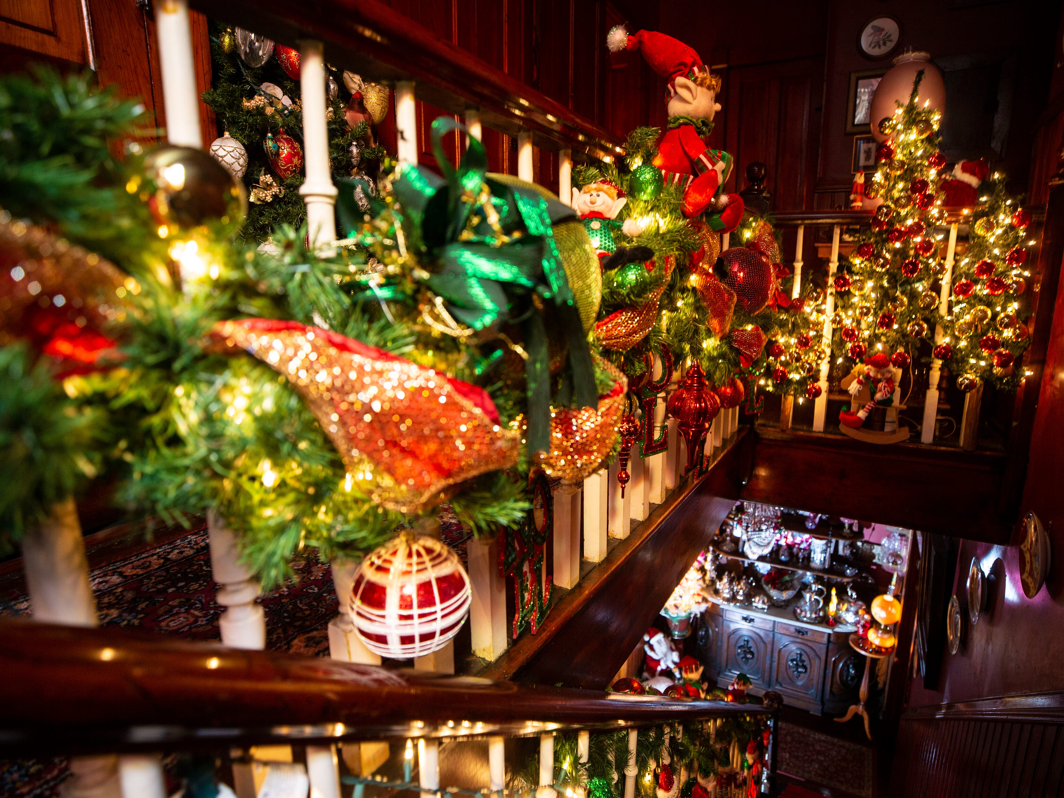 The second staircase is also filled with ornaments and garland. The Victorian-era, three-story home is filled with Christmas and Holiday lights, trees and ornaments that is part of the Old Louisville Holiday Home Tour.