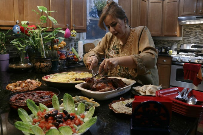 Zainab Radhi made duck, rice, shrimp and roasted eggplant for dinner with her family on a recent Sunday night. She and her sister, Zina Radhi, said food is very important to Iraqi culture.