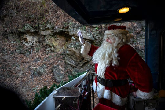 Santa Claus waved from the back of the Santa Train while on its way to Dante, Virginia. Nov. 17, 2018.