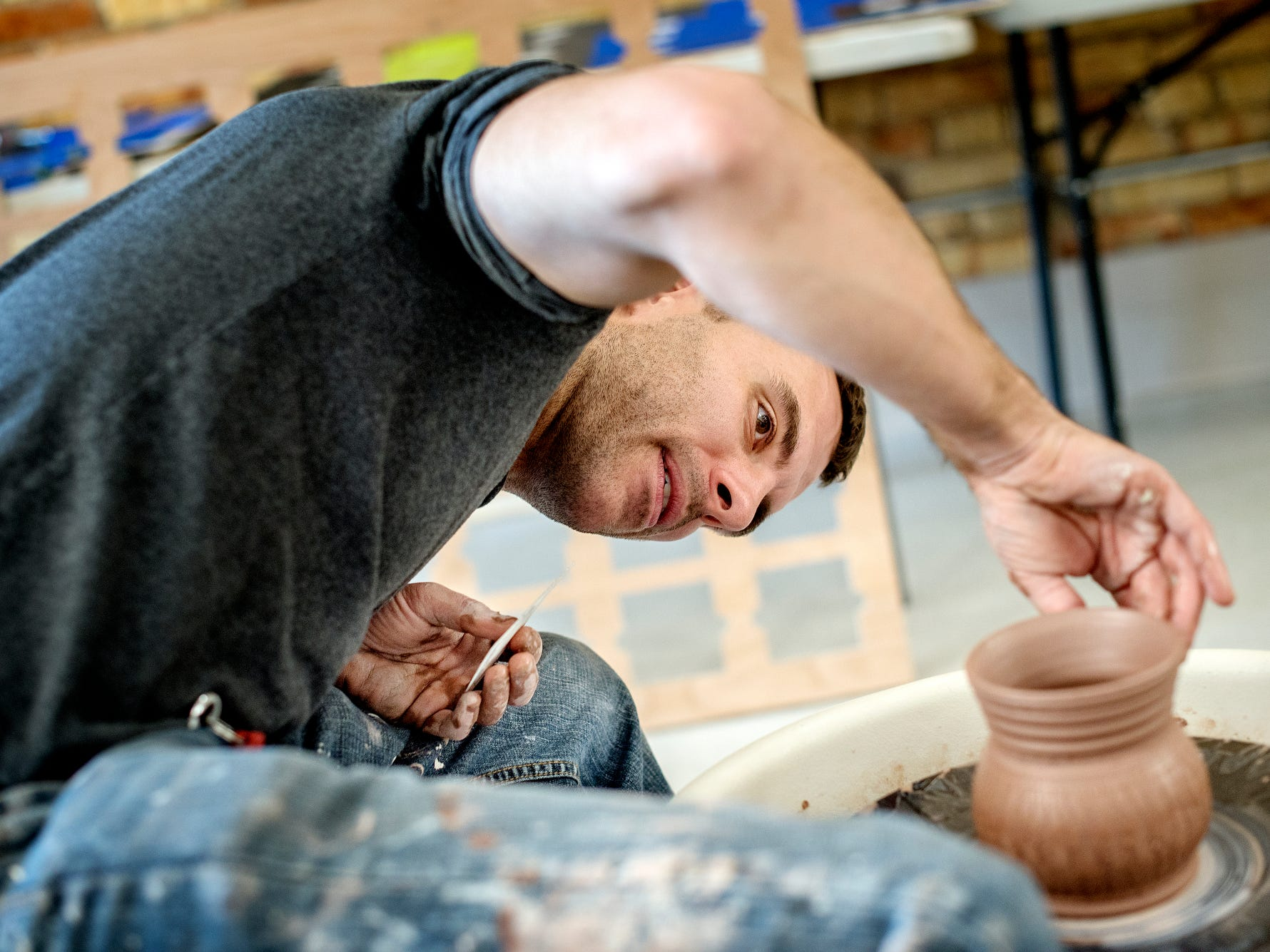 Dan Nunez works on a piece at the Wheel House Studio on Wednesday, Nov. 14, 2018, in Lansing. Nunez opened the business in August.