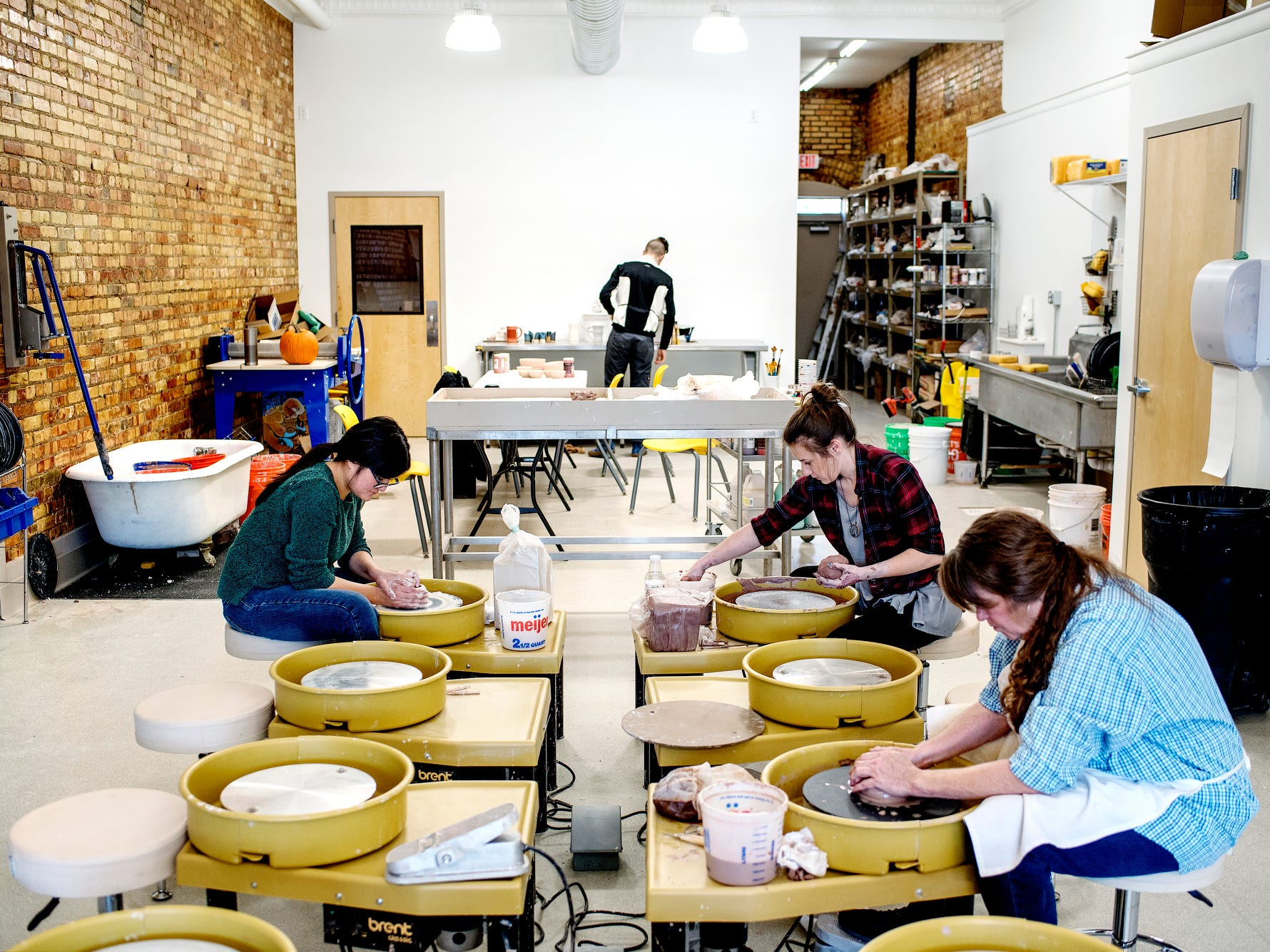 From left, Sandra Wong, Jessica Dart and Carole Schmidt work on pottery at the Wheel House Studio on Wednesday, Nov. 14, 2018, in Lansing.