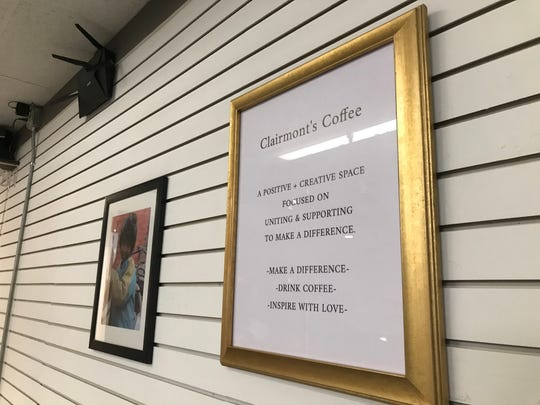 "A sign inside the new Clairmont's Coffee in downtown St. Johns bears the new businesses' motto,""Make a difference. Drink Coffee. Inspire with Love."""