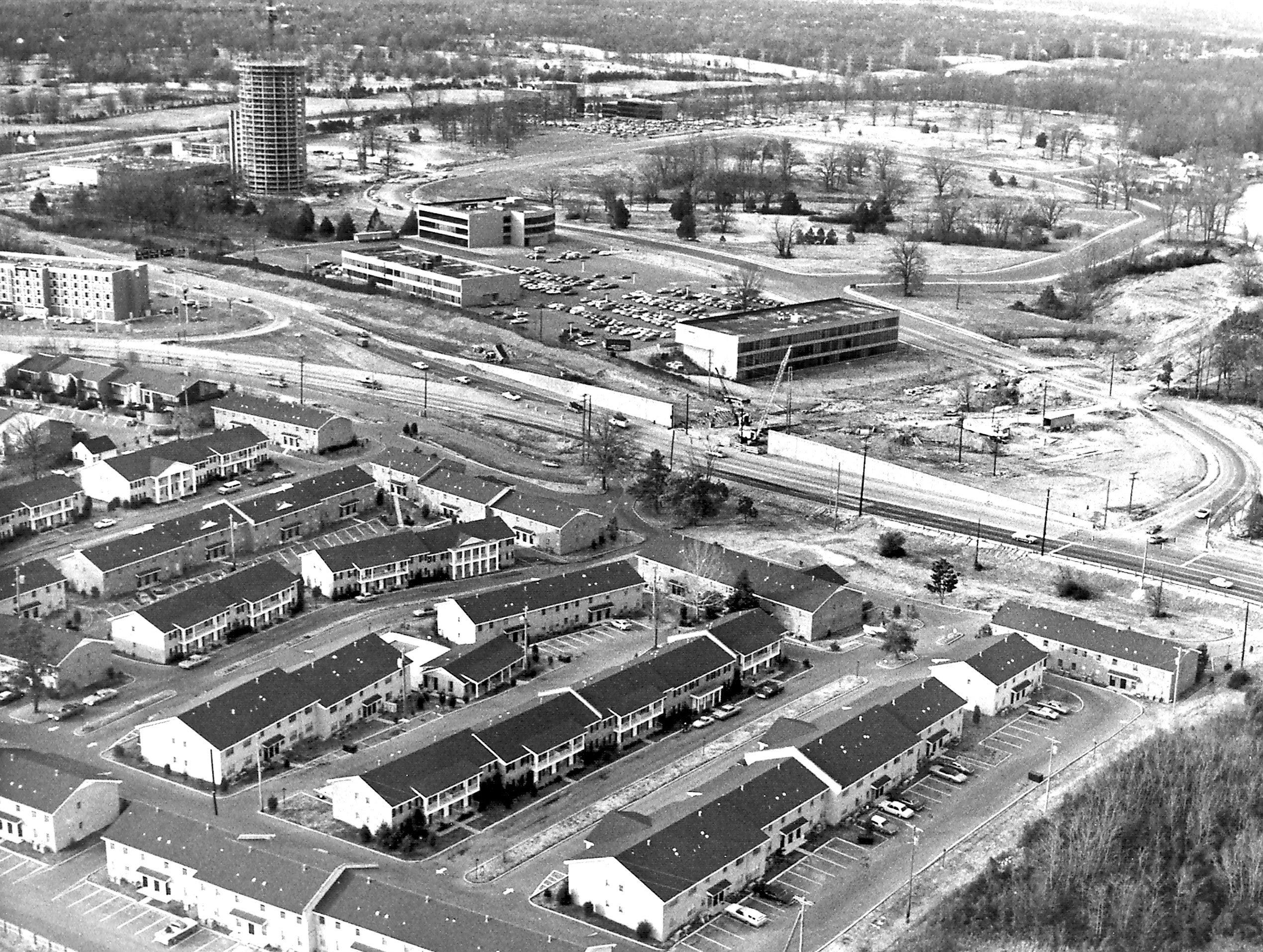 The area on Poplar Avenue east of Interstate 240 as seen from the southeast in  December 1974.  The area north of Poplar is under development where Ridgeway Country Club once thrived.  At upper left, the Hyatt Regency rises above the landscape and work is underway for the overpass for westbound Poplar Avenue traffic in the center of the image.  Apartments in the foreground have given way to a Target store and is still under development.