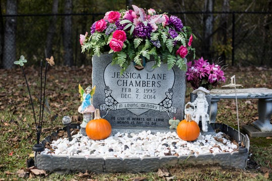 Flowers, pumpkins and butterflies decorate the grave of Jessica Chambers in Pope, Mississippi.