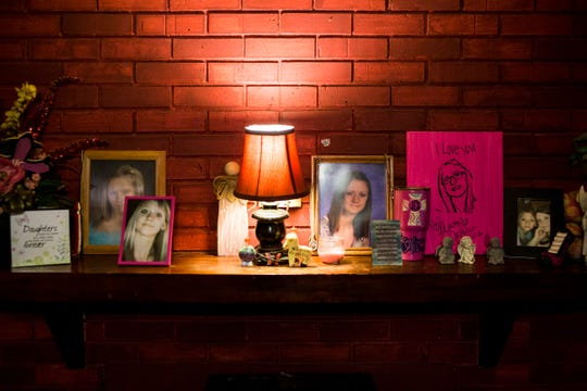Photographs of Jessica Chambers along with other keepsakes are seen on the mantle of Lisa Chambers' home in Courtland, Mississippi.