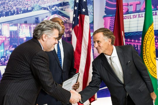 November 19 2018 - Mimeo CEO John Delbridge, left, shakes hands with Governor Bill Haslam during a press conference announcing the relocation of document and manual printer Mimeo.com from New York to Memphis.