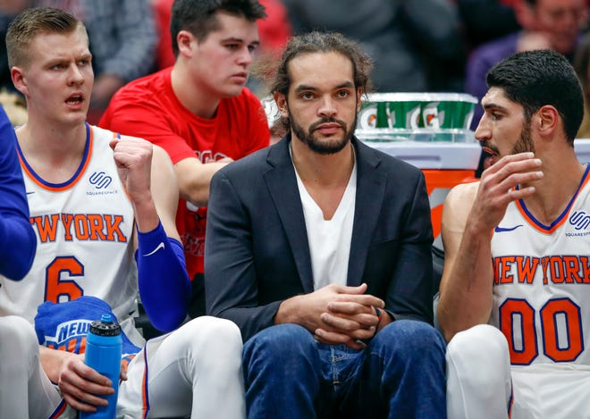 Joakim Noah sits on the bench between Kristaps Porzingis, left, and Enes Kanter during his time with the Knicks. After a rough exit from New York, Noah has landed in Memphis, signing a one-year deal with the Grizzlies.