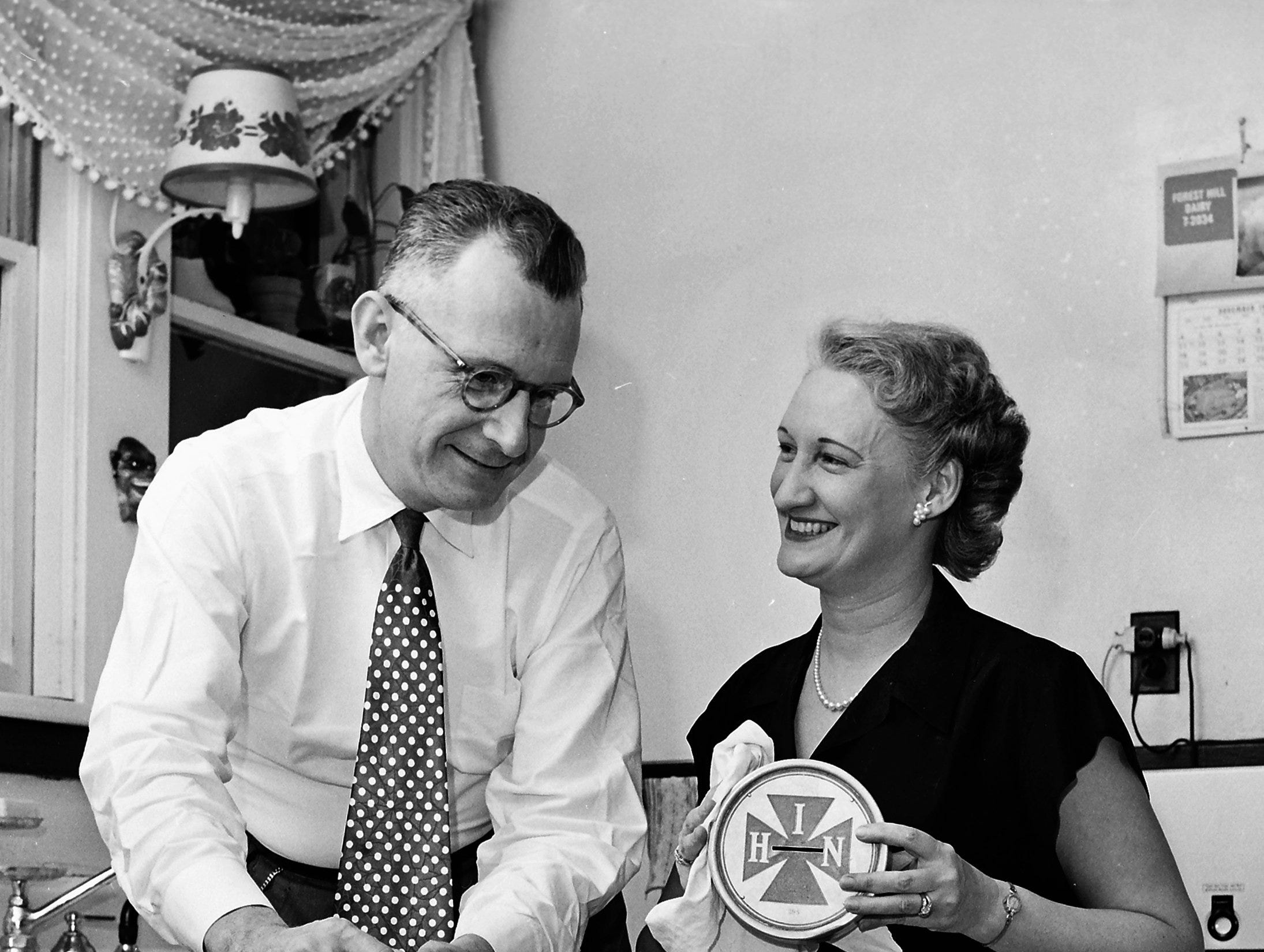 The last of 500 silver and purple collection boxes that will be used by The King's Daughters during their citywide Christmas carol program were made ready in November 1951 by Mrs. Albert Steiner of 276 Malvern, box chairman. Her husband Albert was an able and willing assistant.  Funds collected will be used for the benefit of the Home for Incurables.