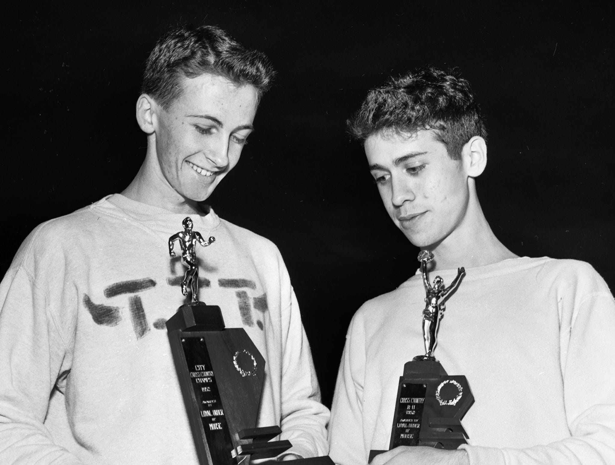 Ralph Thompson (Left) of Treadwell and Pete Cavallo of Christian Brothers College examine the trophies they won for placing one-two in the city-district cross-country run at Audubon Park in December 1952.  Thompson took first and sparked Treadwell to the team championship.