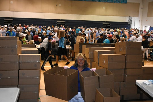 Marie Lynn McChesney works with the crew assembling an endless stream of boxes. Marco Island volunteers packed a quarter of a million meals to feed those in need of food at the Meals of Hope packaging event Saturday morning at Marco Island Charter Middle School.