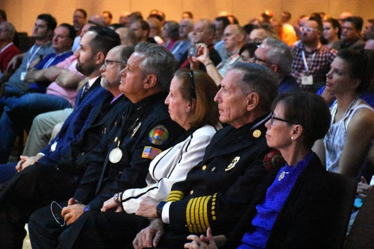 Barbara Murphy, right, sits next to her husband, Fir-Rescue Chief Mike Murrphy. Marco Island first responders, city staff, and host JW Marriott were recognized for their efforts during and after Hurricane Irma during a security dealers' conference at the hotel on Saturday.