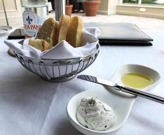 A bread basket, ricotta cheese spread and oil from Sale e Pepe, Marco Island.