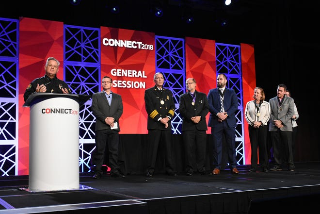 Police Chief Al Schettino speaks to the 800 attendees. Marco Island first responders, city staff, and host JW Marriott were recognized for their efforts during and after Hurricane Irma during a security dealers' conference at the hotel on Saturday.