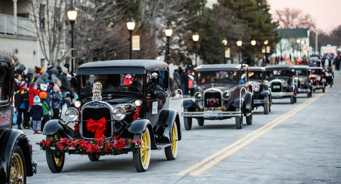 Members of the Model A Ford Club of America rumble into town during the 56th annual Waukesha Christmas Parade on Sunday, Nov. 18, 2018.