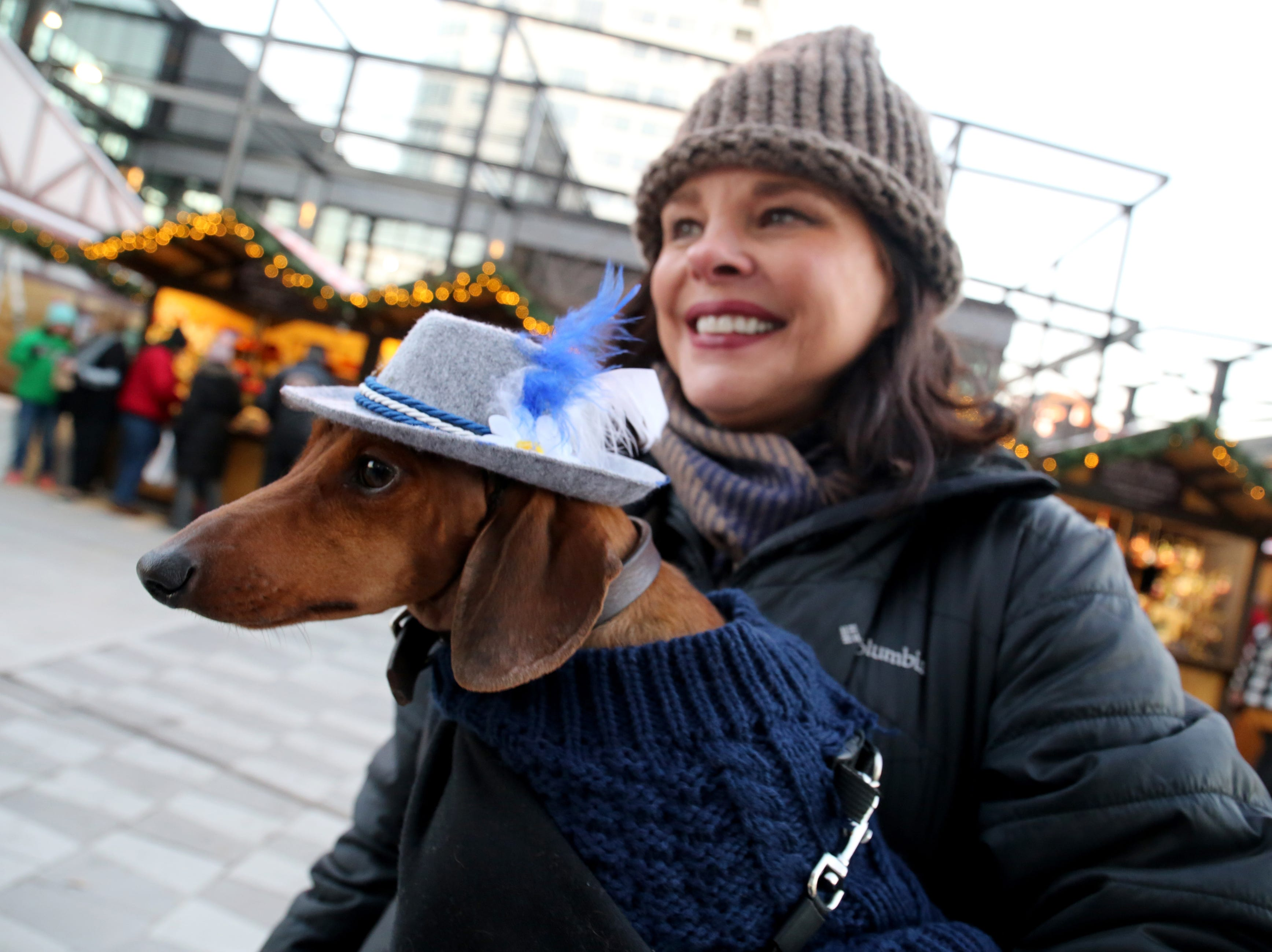 Nan Bonyata, from Lake Geneva, holds Huck, her two-year-old dachshund wearing a traditional German hat.