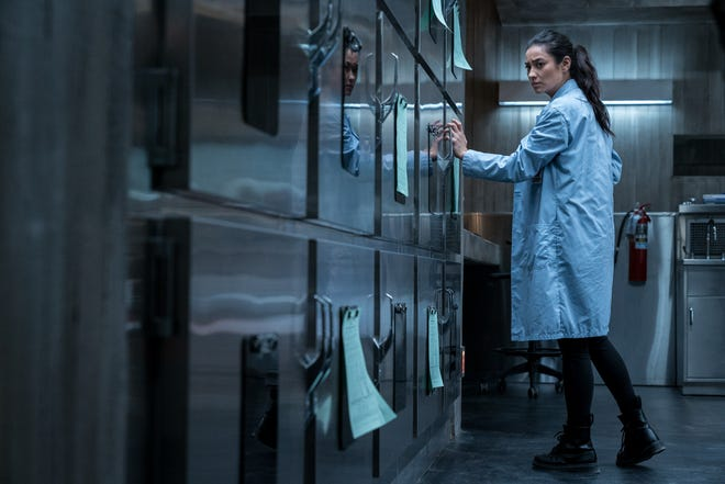 "Megan (Shay Mitchell) realizes that something is not right in Hanna Grace's cadaver drawer in ""The Possession of Hannah Grace."""