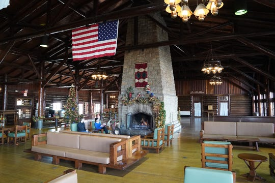 The Great Hall at Starved Rock Lodge features a large two-sided fireplace.