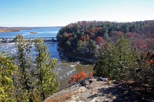 An overlook on Starved Rock provides a view of a lock and dam on the Illinois River and another overlook known as Lover's Leap.