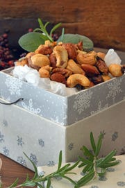 Package Sage and Rosemary Spiced Nuts in a festive box for the hosts' post-party munching.