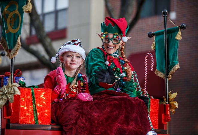 Santa's Elves wave from atop the Whistles on Wheels float during the annual Waukesha Christmas Parade in 2018. The 2020 parade, set for Sunday, has been canceled due to the coronavirus pandemic.