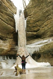 An icefall covers a wall in Starved Rock State Park's St. Louis Canyon in the winter.