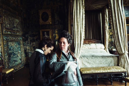 "Rachel Weisz attends to the queen (Olivia Colman, right) in ""The Favourite."""