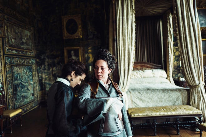 """Rachel Weisz attends to the queen (Olivia Colman, right) in """"The Favourite."""""""