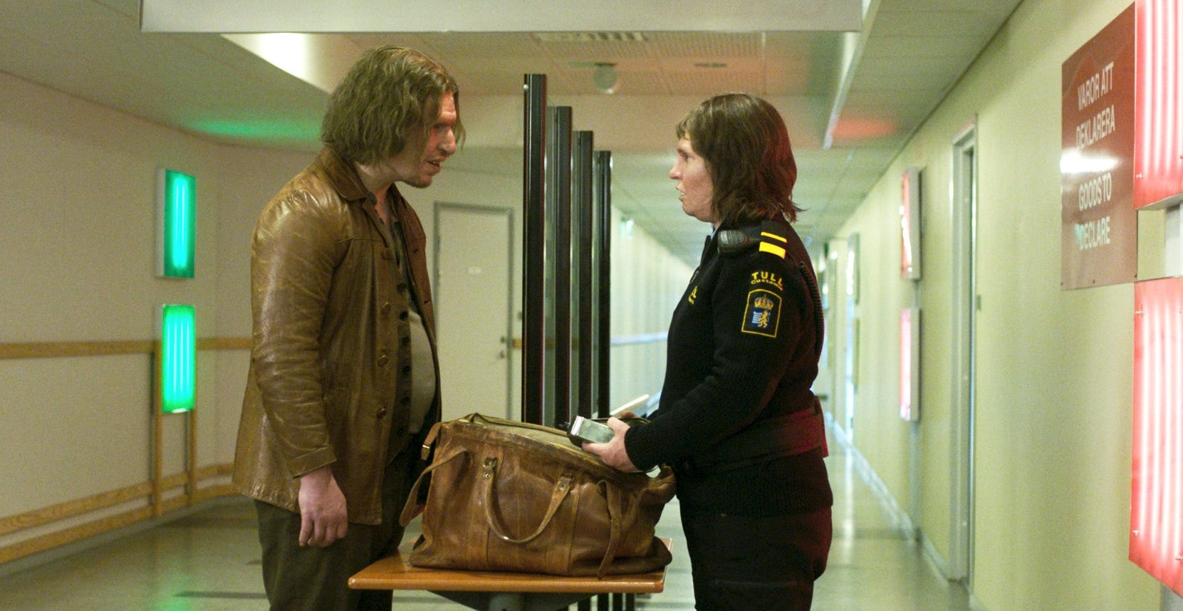 "Vore (Eero Milonoff), a mysterious traveler, poses a challenge for Swedish customs official Tina (Eva Melander) in ""Border."""