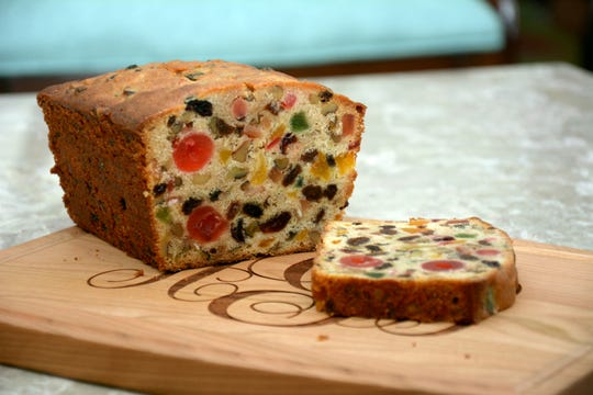 Wary of holiday fruitcakes? Not so fast. This Golden Fruitcake is colorful and delicious. (This cutting board, with the author's monogram, is from Hello World Paper Co.)