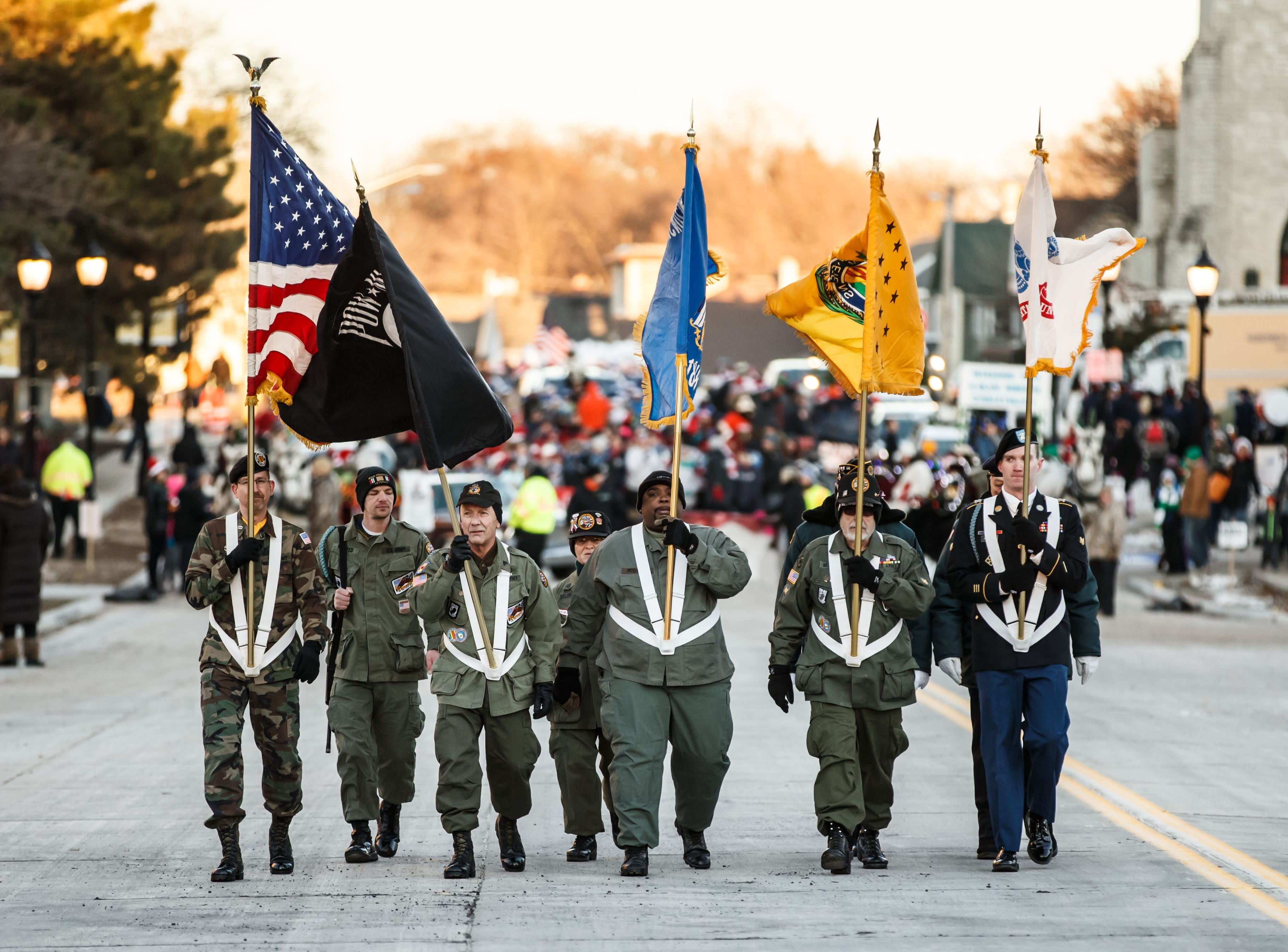 Members of the Vietnam Veterans of America Waukesha Chapter 425 march in the 56th annual Waukesha Christmas Parade through town on Sunday, Nov. 18, 2018.