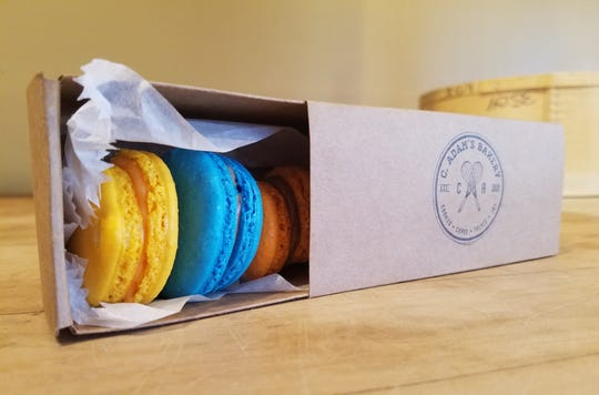 Colorful macarons from C. Adam's Bakery are a sweet treat for the host.