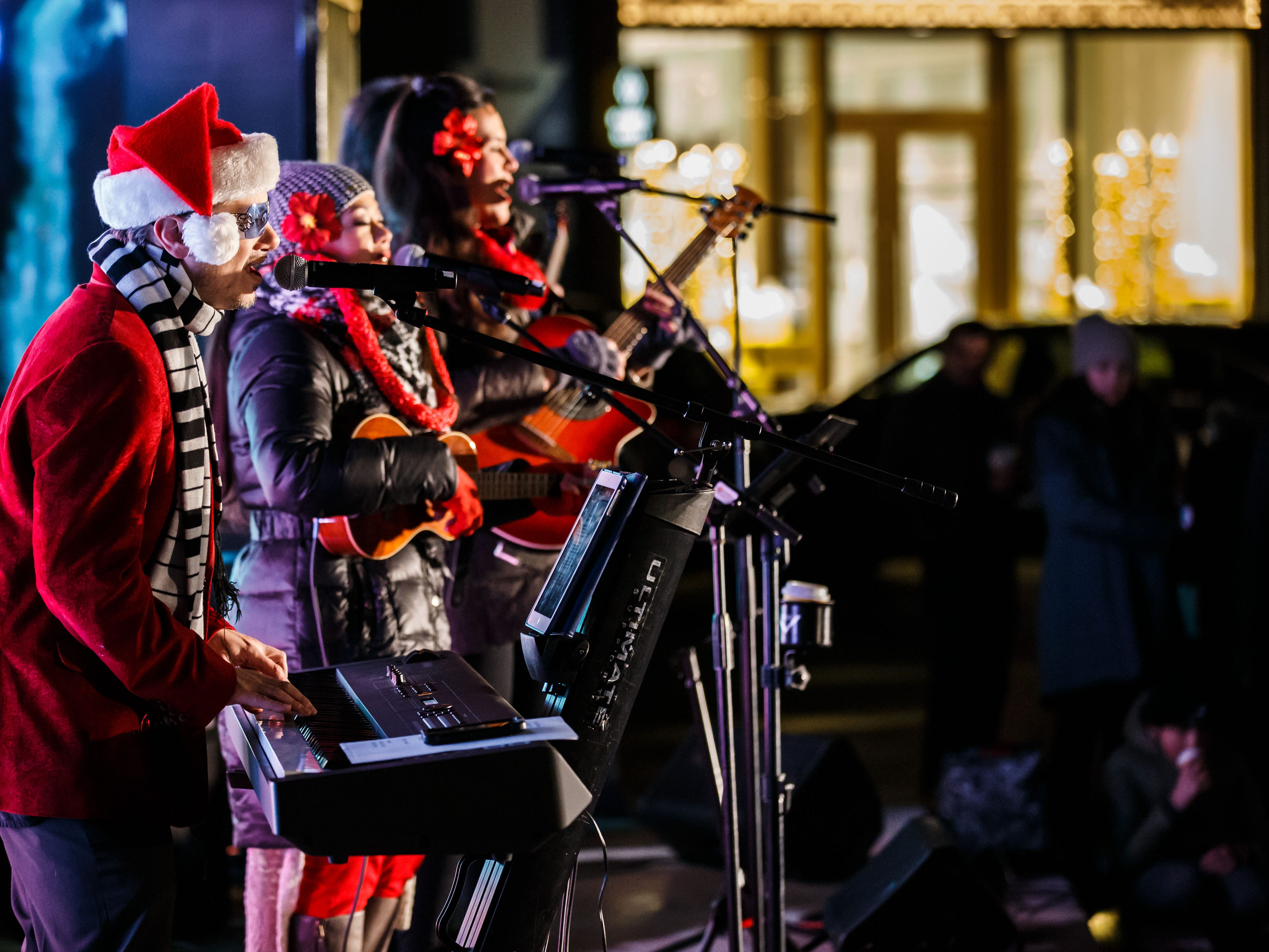 "Milwaukee band Ocean Rush performs during the second annual ""Lighting of The Corners"" in Brookfield on Saturday, Nov. 17, 2018. The event features live music, photos with reindeer, holiday crafts, a visit from Santa and the Winter Princesses, and the lighting of a 30-foot tree."