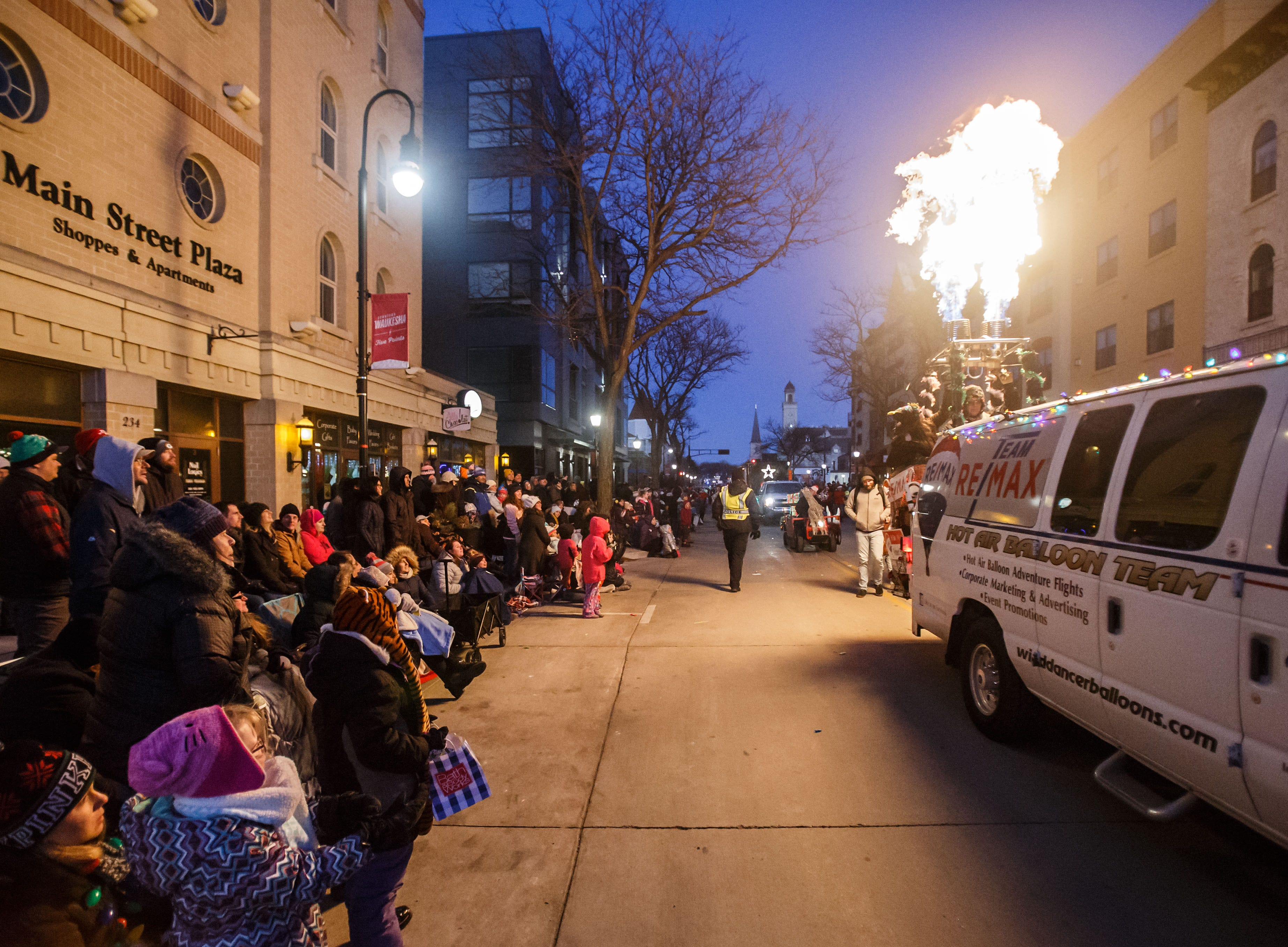 Flames from the WindDancer hot air balloon team captivate parade-goers during the 56th annual Waukesha Christmas Parade on Sunday, Nov. 18, 2018.