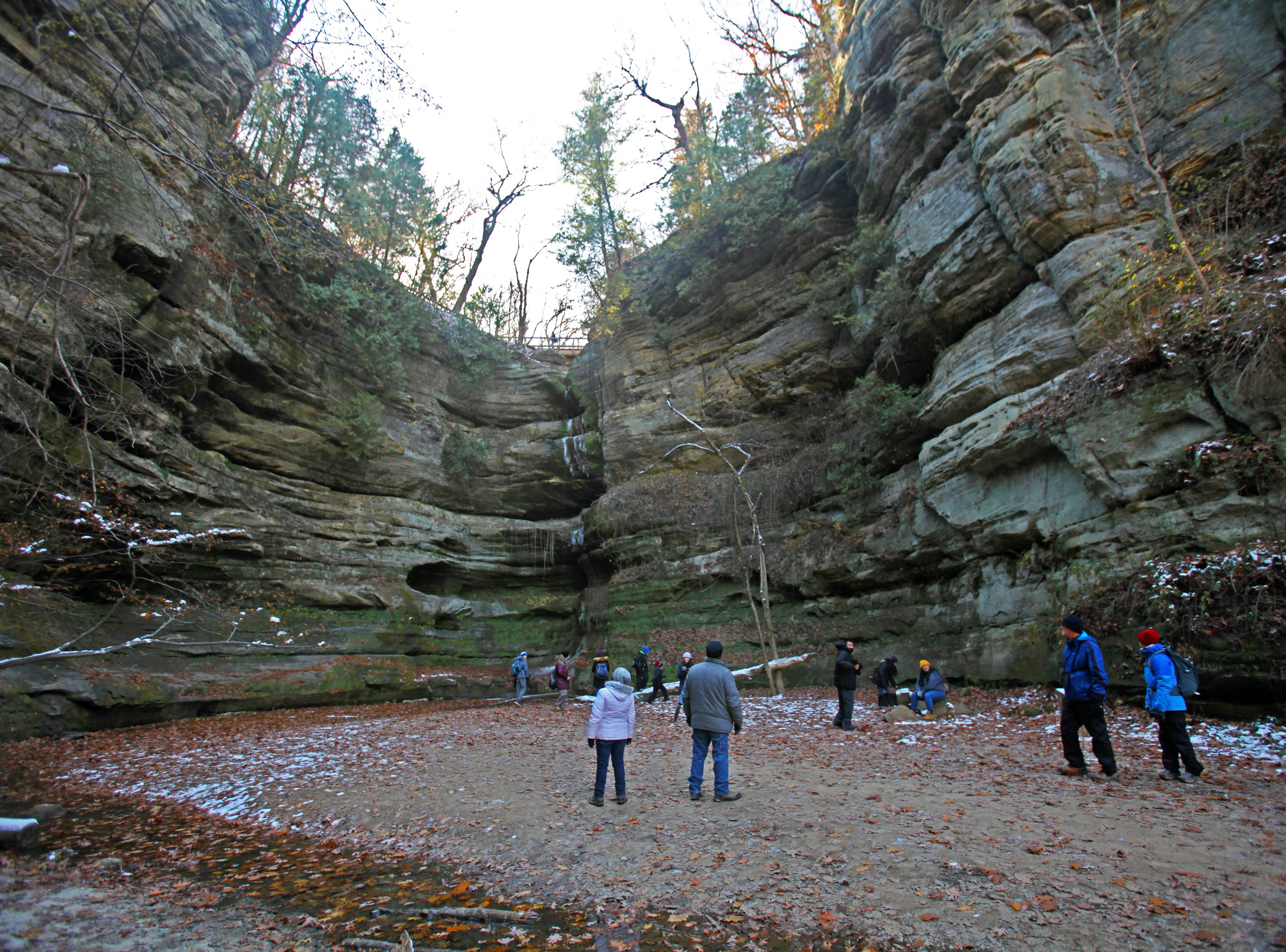 The walls of Wildcat Canyon rise high above hikers at Starved Rock State Park near Utica, Illinois.