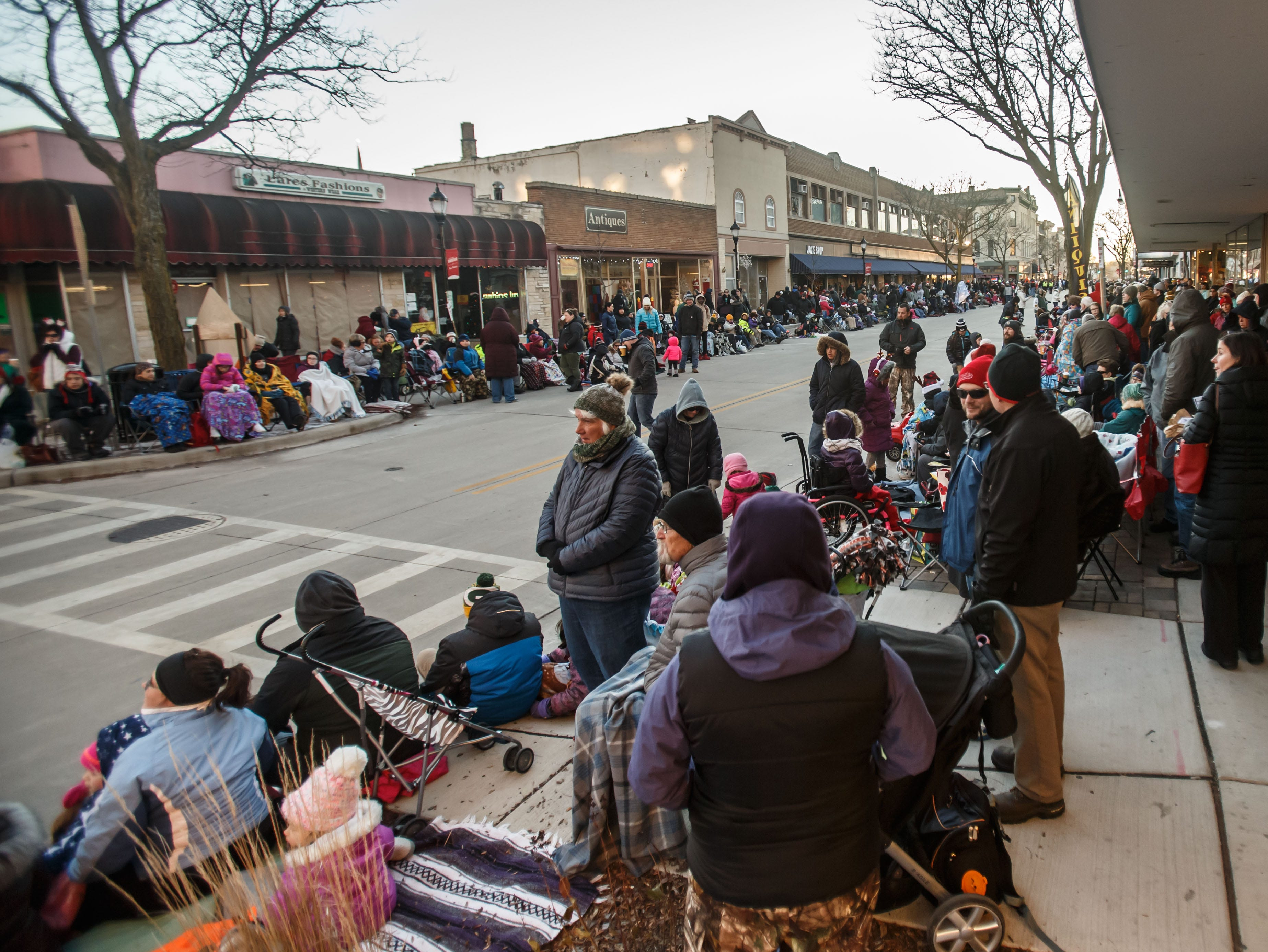 Parade enthusiasts flock to downtown Waukesha for the 56th annual Waukesha Christmas Parade through town on Sunday, Nov. 18, 2018.