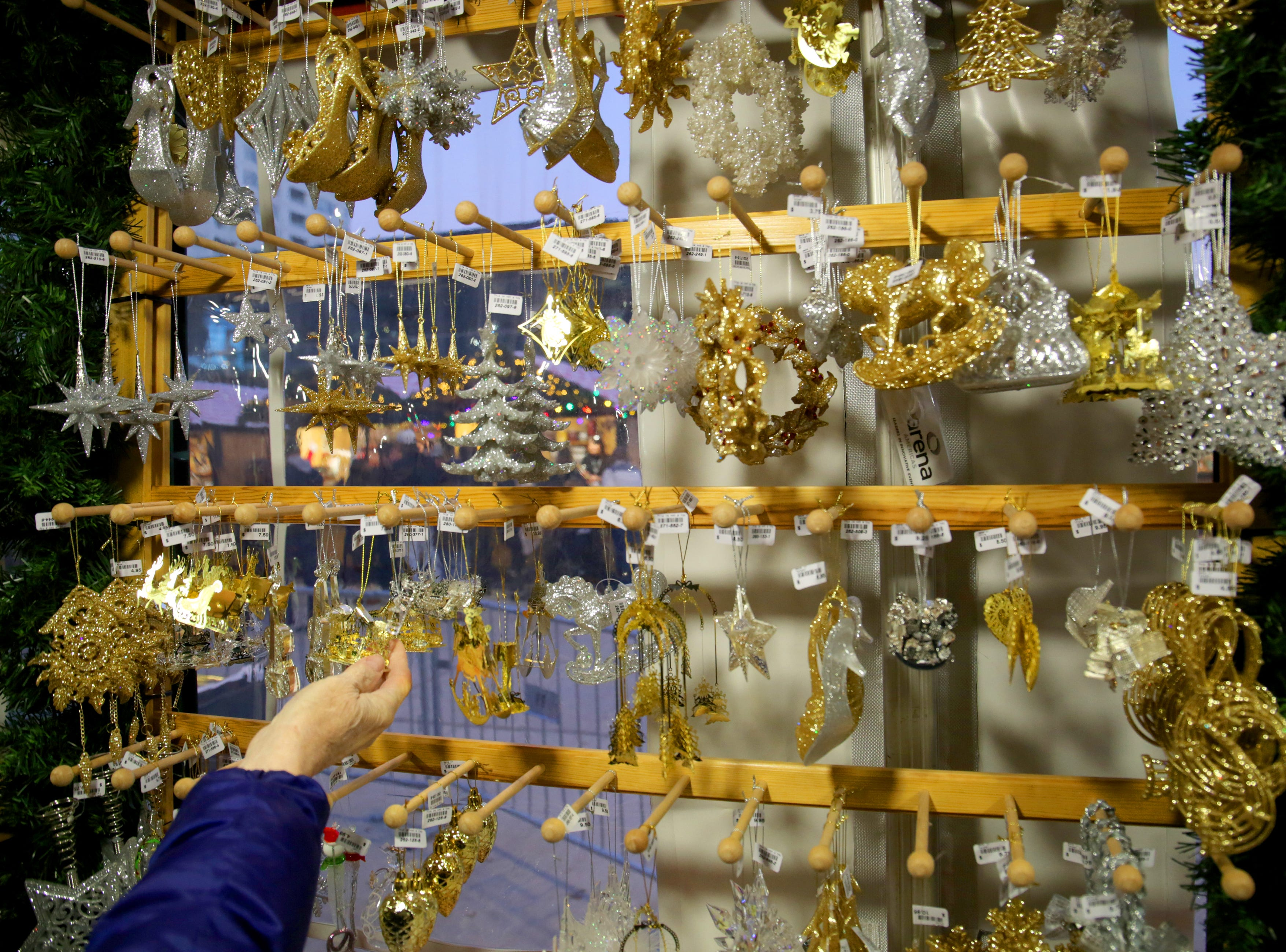 Several different types of ornaments are on display in the Kathe Wohlfahrt mini store.